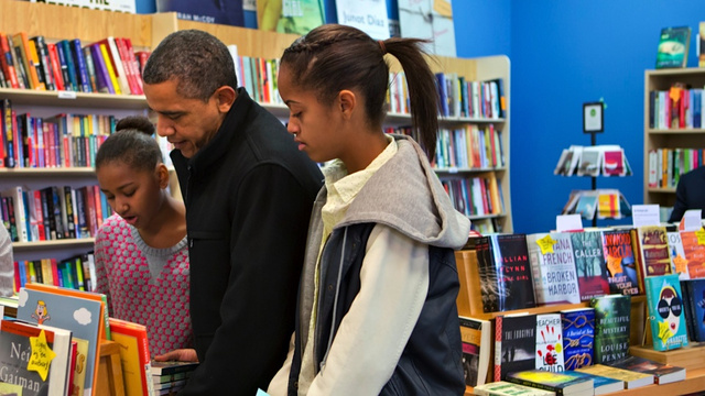 POTUS Takes Sasha and Malia to an Edgy Ancient Recycled Tree Exhibit Called 'Independent Bookstore'