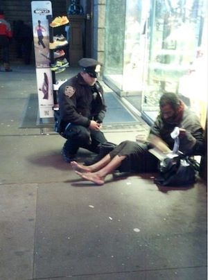 Arizona Tourist Takes Heartwarming Photo of NYPD Officer Giving New Pair of Boots to Homeless Man