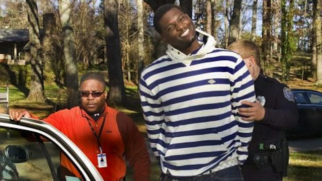 Photoshop Contest: Raiders LB Rolando McClain's Fantastic Perp Walk Grin