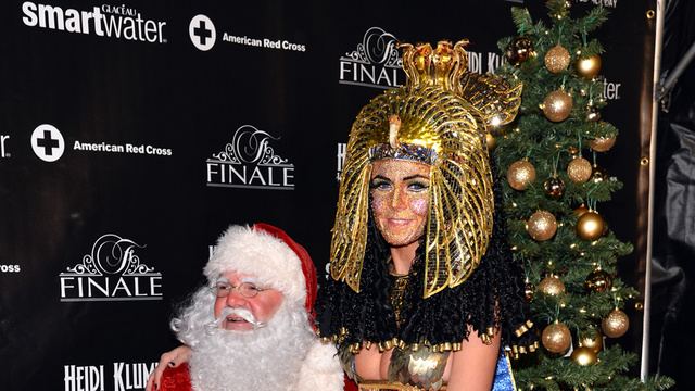 Heidi Klum Bedazzles Own Face and Sits on Santa's Lap For Halloween Party