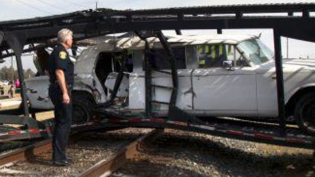Click here to read A Train Hit A Truck And Made A Rolls Royce Sandwich