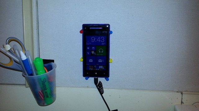 Use Push Pins for a Cheap and Easy Phone Dock for Your Cubicle
