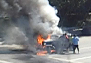 VIDEO: Mystery Good Samaritans Pull Man Out Of Fiery Car Wreck
