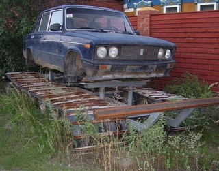 In Mother Russia, Lada Rolls Over Tank!