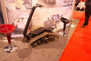 No One Looks Cool On This Goofy Tracked Snowmobile