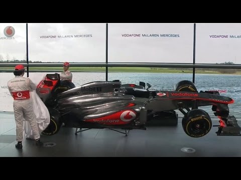 Click here to read The McLaren MP4-28 Gets A Nose Job And A New Wheelman