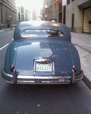 Jensen GT and Jaguar Mk IX Down On The Boston Street