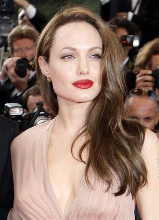 Angelina Is All-Powerful; Clooney's Getting Served; Ricci's Romance Over?