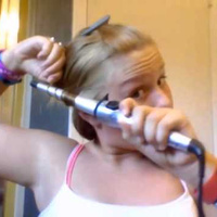YouTube Beauty Guru Attempting to Teach Hair Curling Ends Up Burning Her Hair Off