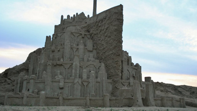 Click here to read Massive sandcastle Minas Tirith awaits the approaching onslaught of waves
