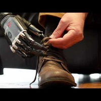 Watch the Real-Life Terminator Hand Tie Shoes, Deal Cards, and Improve This Man's Life