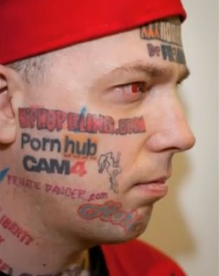 'Human Billboard' Who Tattooed Porn Site Names on His Face Says He May Have Made a Big Mistake