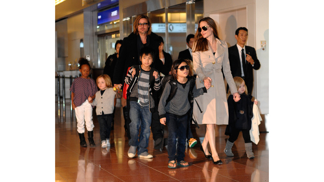 Angelina, Brad & Chicly Color-Coordinated Brood Arrive In Japan