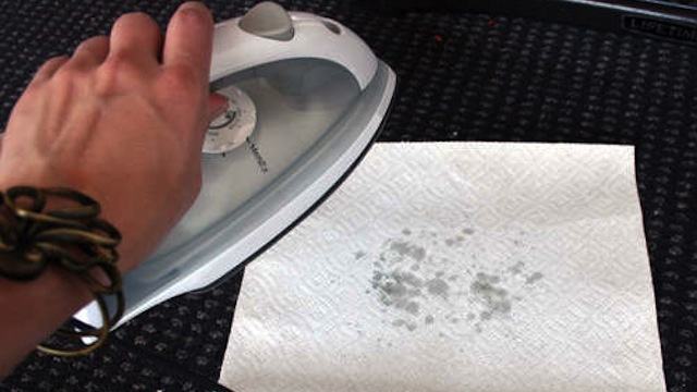 Use an Iron and Paper Towels to Remove Melted Wax from Rugs and Carpet
