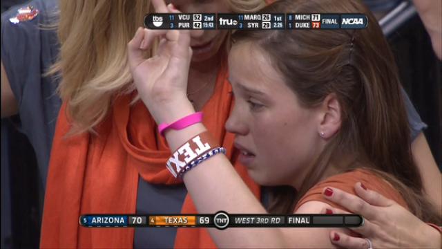 Even Through The Tears, Young Texas Fan Manages A Brave Hook 'Em Horns