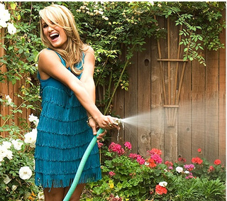 Jenn Brown Is Ready For Her Close-Up While Spraying A Garden Hose