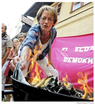 Swedish Feminists Burn Over $10,000 In Protest
