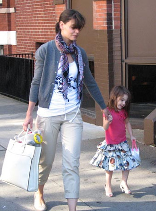 Katie Defends Suri's High-Heel Habit; Tiger Pulls Out Of Golf Tournament