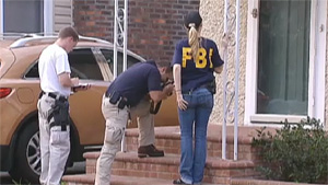 FBI Raids New York Homes in Anonymous Investigation