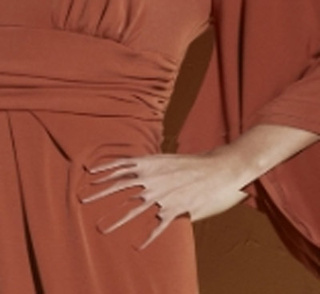 The Dress Is Lovely, But the Mutant Prong Hand Is the Stuff of Nightmares