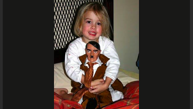 Frightening Girl Loves Her Hitler Doll