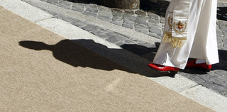 The Pope's Ruby Red Slip-Ons