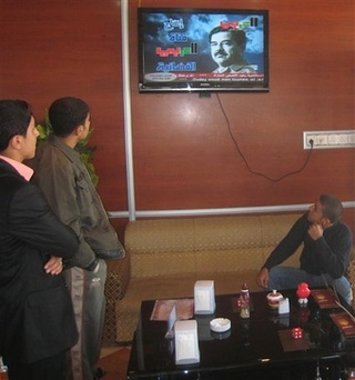 Saddam Returns! With Mysterious Satellite TV Channel that Alternately Terrorizes and Bores