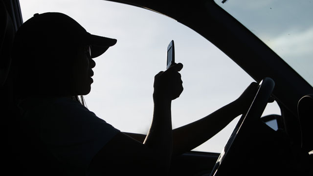 Man Loses License After Using Two Cell Phones While Driving