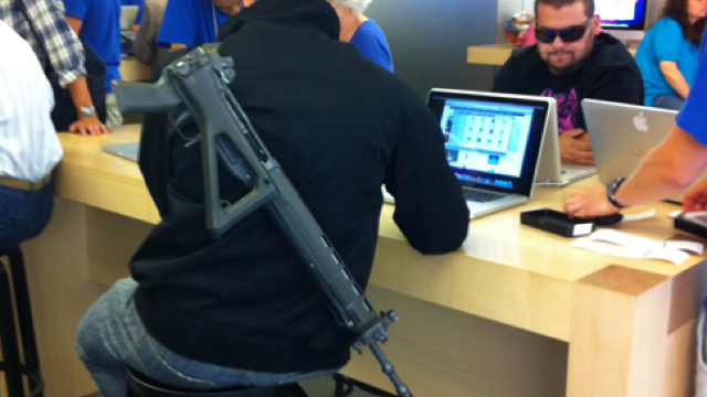 Why Does This Guy Have an Assault Rifle at the Apple Store?