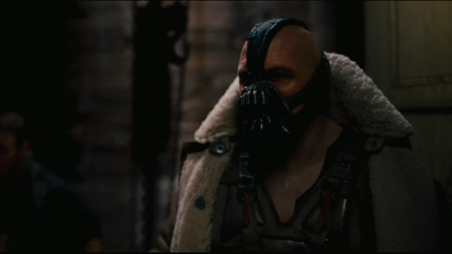 Will the studio make Christopher Nolan change Bane's voice in The Dark Knight Rises?