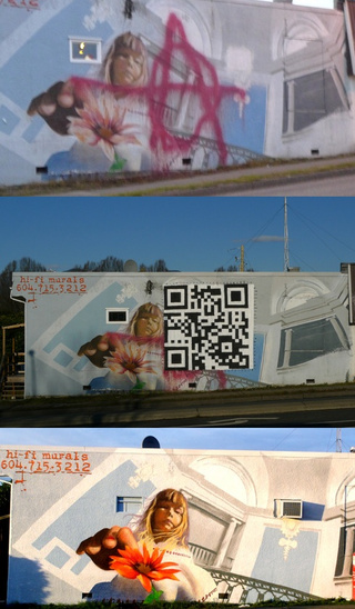Artist repairs vandalized mural with giant QR code (that leads back to the pre-defaced artwork)