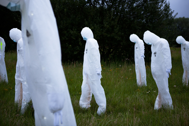 Horde of 100 radiation suit-clad specters invades German music festival