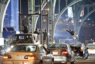 Oscorp HQ, Peter Parker and Gwen Stacy on the street, and a daring bridge stunt being prepped