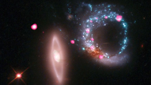 A ring of blue.  A ring of pink.  And a ring of black holes.