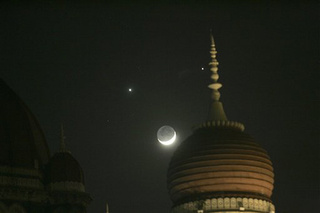 Venus and Jupiter Glow Like Eyes Next to the Mouth of the Moon
