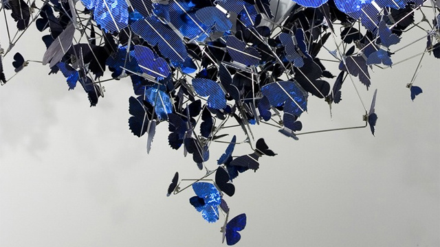 A Chandelier With Hundreds of Mini Perched Solar Cell Butterflies
