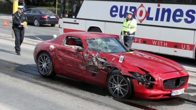 Day-old Mercedes SLS AMG crashes into bus