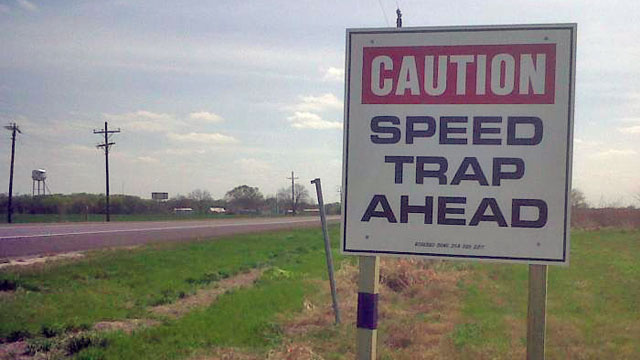 Police officer fired after attacking speed-trap warning sign