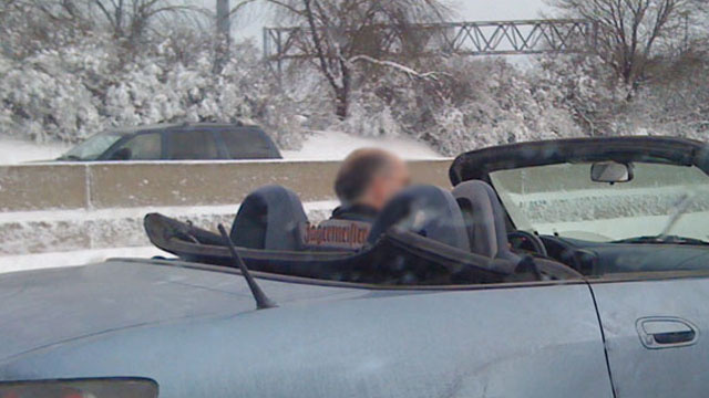 How baller is a top-down Honda roadster on a Detroit freeway during a blizzard?