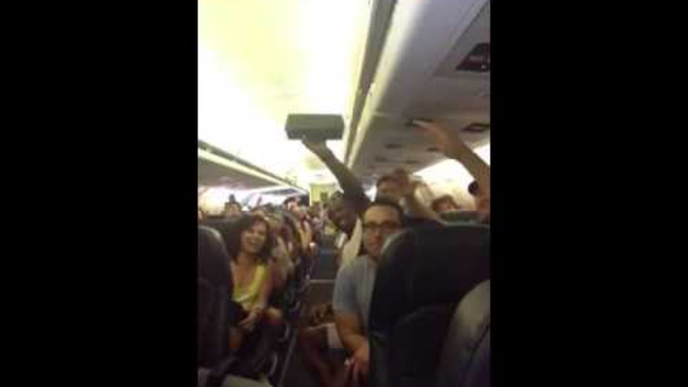 Passengers Stuck on Broken Plane for Hours Sing 'I Believe I Can Fly'