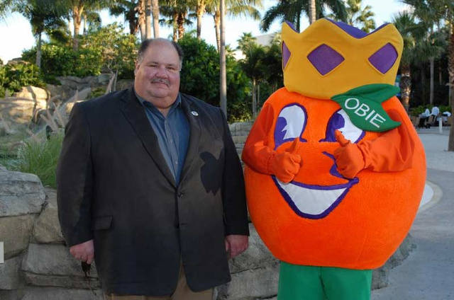 Former Kansas coach Mark Mangini and Obie the Orange (Orange Bowl Mascot)