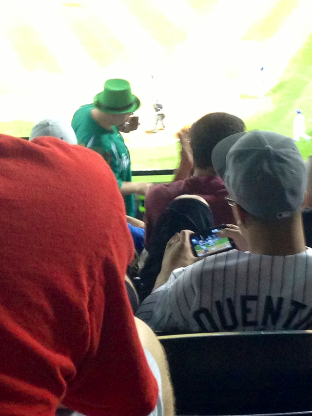 Bored Baseball Fans Play Baseball Videogames At Baseball Game