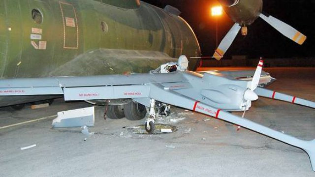 Watch This German UAV Crash into a Plane on an Afghan Runway