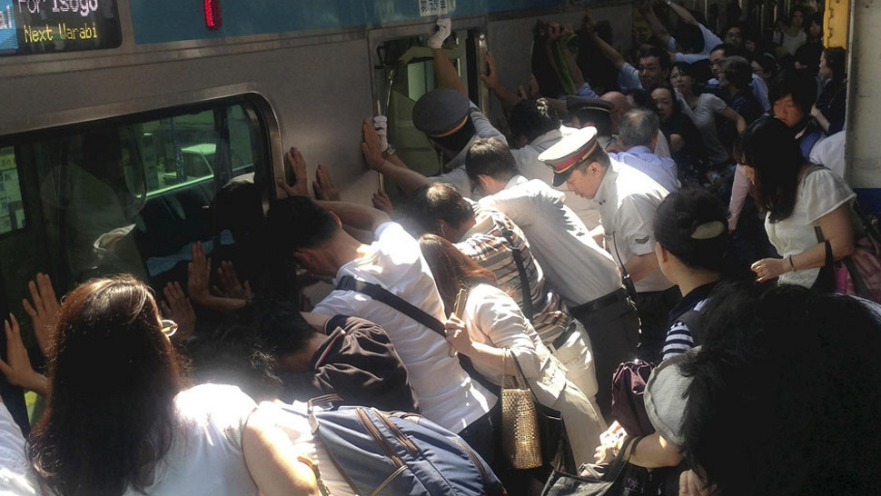 Commuters Unite to Push Entire Train Car Off Trapped Passenger