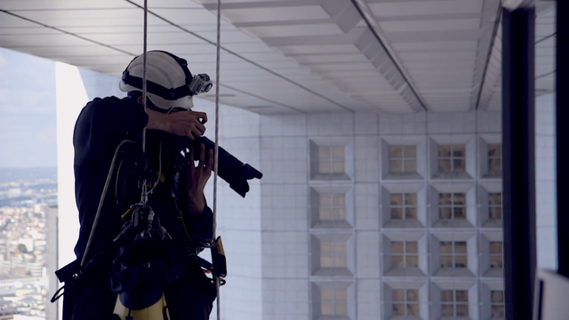 Daredevil Photographer Rappels Down Skyscrapers For the Perfect Shot