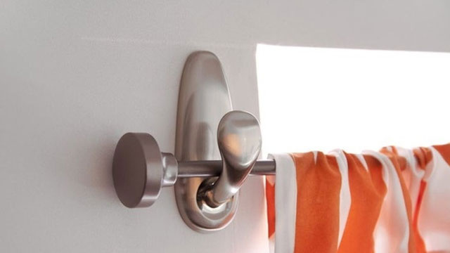 The easy way to put up a curtain rod without poking holes in your wall ...