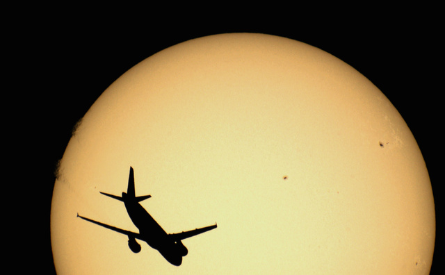 Perfectly Timed Pics of Airplanes Silhouetted Against the Sun and Moon