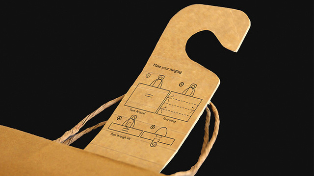 A Paper Shopping Bag That Transforms Into a Hanger Back Home
