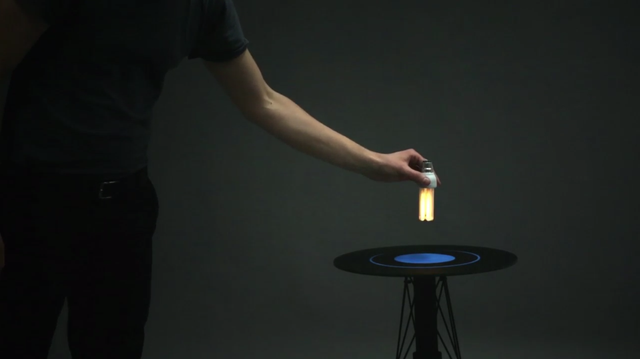 This Magical Table's Electromagnetic Field Turns On Nearby Light Bulbs