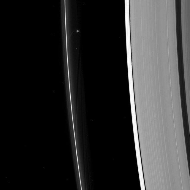 Just Look at What Saturn's Moons Do To Its Rings